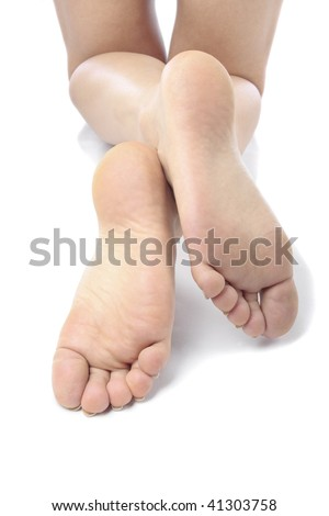 Woman feet and  legs isolated over white background - stock photo