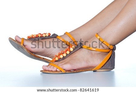woman feet in summer sandals shoes - stock photo