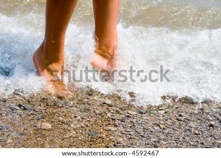 woman feet in the beach - stock photo