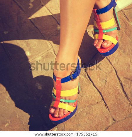 Woman feet with high-heel shoes walking.  pool. Photo toned style instagram filters  - stock photo