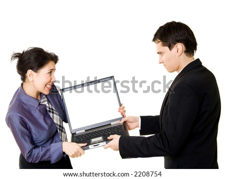 Woman fighting with man for a laptop - stock photo