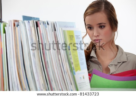 Woman filing documents - stock photo