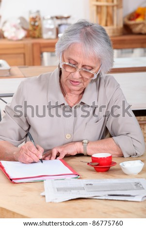 Woman filling out forms - stock photo