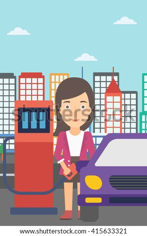 Woman filling up fuel into car. - stock photo
