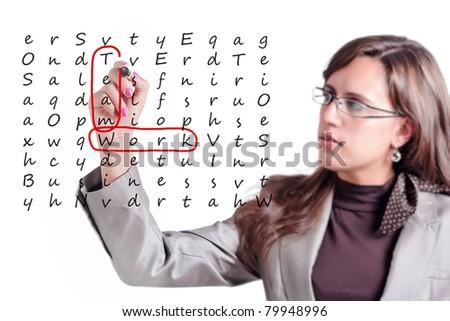 Woman finds on a whiteboard crosswords a few key points of Teamwork - stock photo