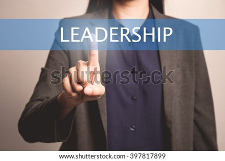 woman finger pointing at the camera with leadership word - stock photo