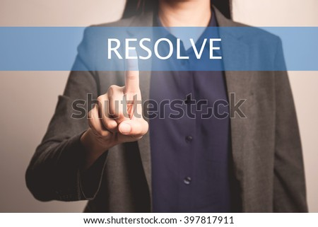 woman finger pointing at the camera with resolve word - stock photo