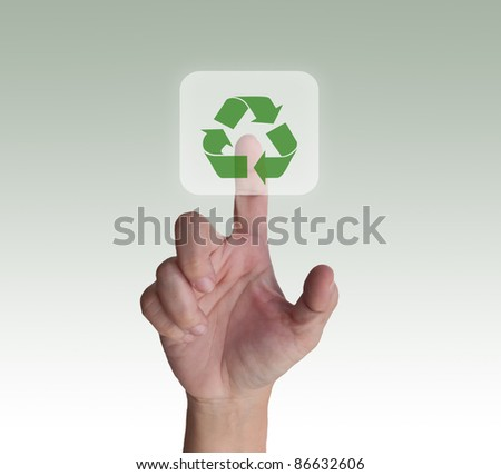 woman finger pressing recycle button - stock photo