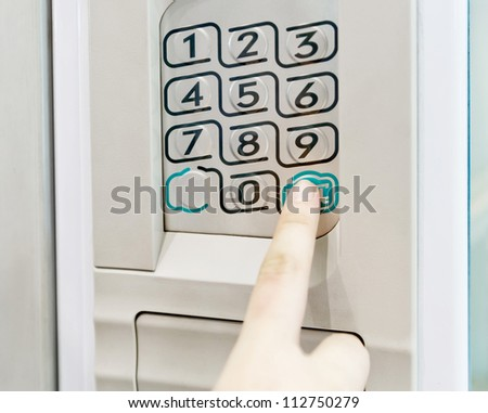 Woman finger pushing button - stock photo