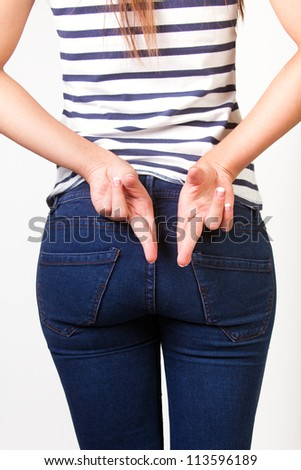 woman fingers crossed on his back - stock photo