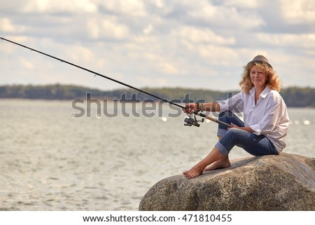 woman fisher sitting looking at camera