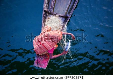 Woman fishing, Bangladesh - stock photo