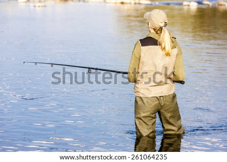 woman fishing in the river - stock photo