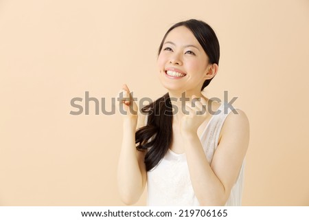 Woman fist pumped celebrating success