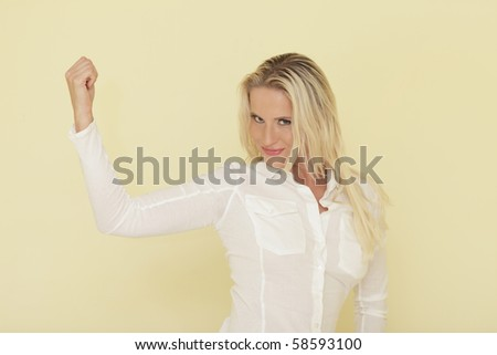 Woman flexing her strong arm