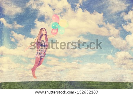 woman flies on the balloons in the clouds - stock photo