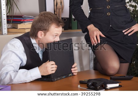 woman flirting with a man by the work - stock photo