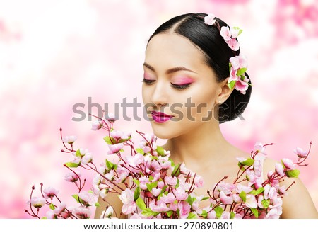 Woman Flowers Bunch Pink Sakura, Girl Makeup Beauty Portrait, Asian Model Fashion Face Make up, Floral Background - stock photo