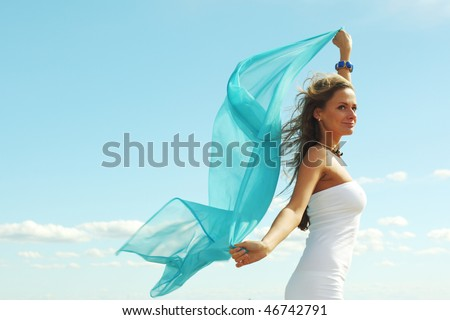 woman fly in the blue sky