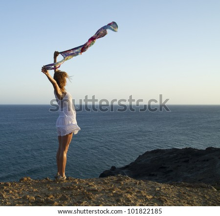 woman flying a handkerchief on the beach