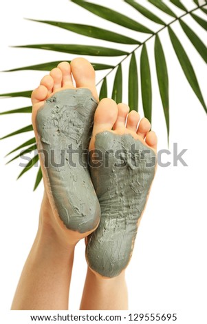 Woman foots with cosmetics, isolated on white - stock photo