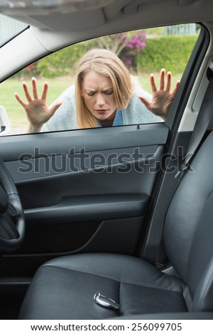 Woman forgot her key inside of her car - stock photo