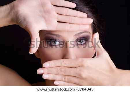 woman framing her eyes with hands