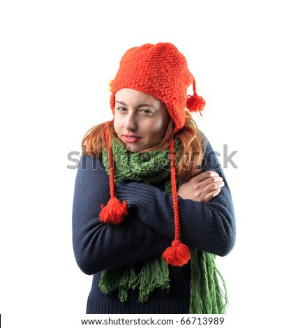 Woman freezing in winter clothes - stock photo