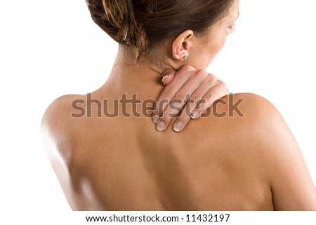 Woman from behind, naked body, holding her neck on the right side. Face to the right. - stock photo