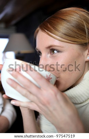 Woman from large mug - stock photo