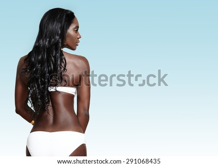 woman from the back side with a long curly hair wearing bikini - stock photo