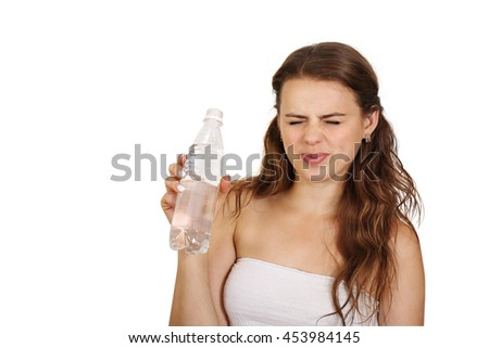 Woman frown on bad water from a bottle