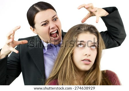 Woman furious with teenage daughter  - stock photo