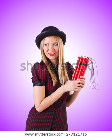 Woman gangster with dynamite sticks on white - stock photo