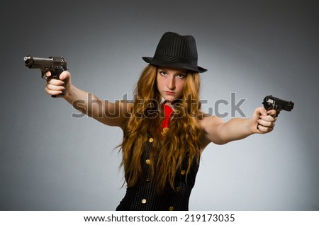 Woman gangster with gun in hand - stock photo
