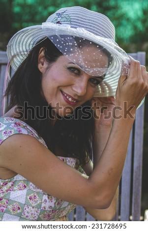 Woman gardening. Mature girl gardening in her backyard. spring season, rural scene - stock photo