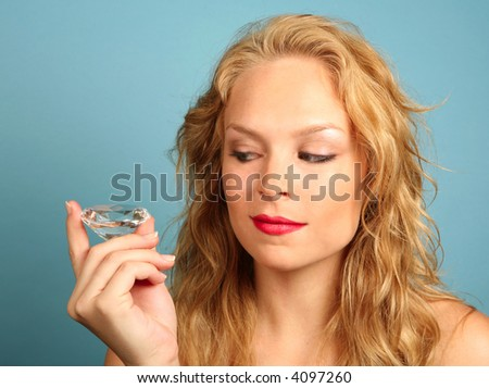 Woman Gazing at a Large Diamond With Desire - stock photo