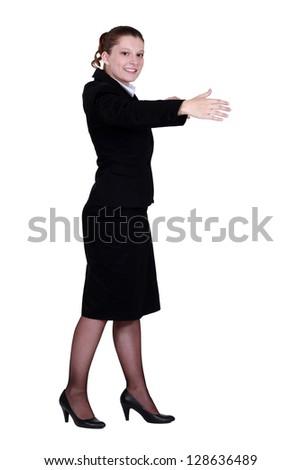 Woman gesturing a hug. - stock photo