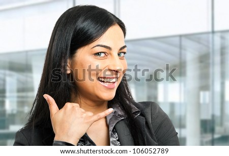 Woman gesturing a telephone symbol - stock photo