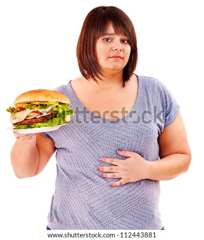 Woman get abdomen pain after eating fatty food. Isolated. - stock photo