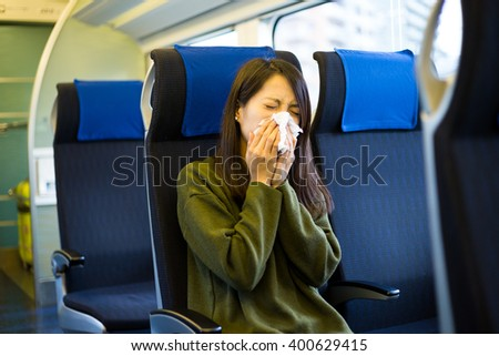 Woman get cold in train compartment - stock photo