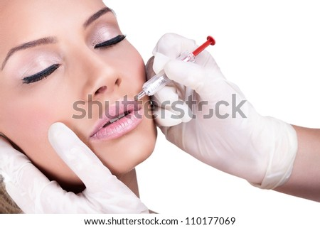 Woman gets cosmetic injection of botox. Beauty Treatment - stock photo