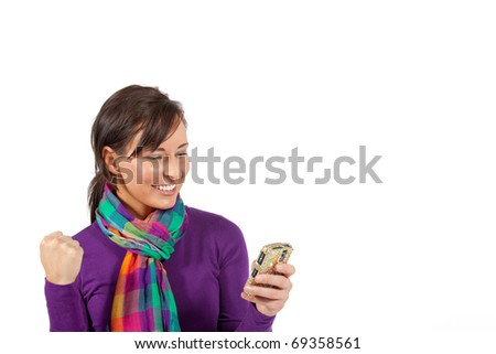 woman gets excited by what's on her cell phone - stock photo