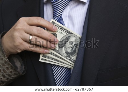 Woman gets money from the businessman's pocket