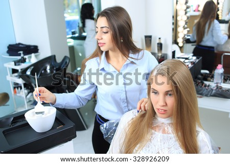 Woman gets new hair colour - stock photo