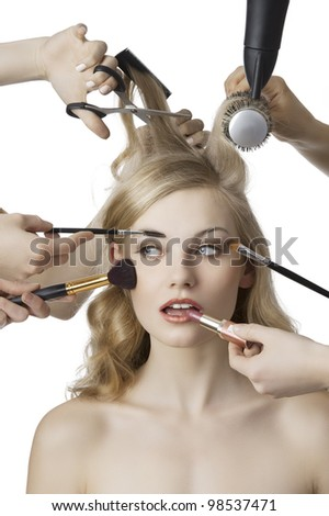 woman getting a beauty and hair style in the same time with hands making differente works
