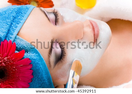 woman getting a beauty mask - stock photo