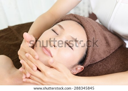Woman getting a facial massage