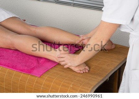 Woman getting a foot massage - stock photo