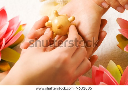 Woman getting a hand massage (close up on hands)